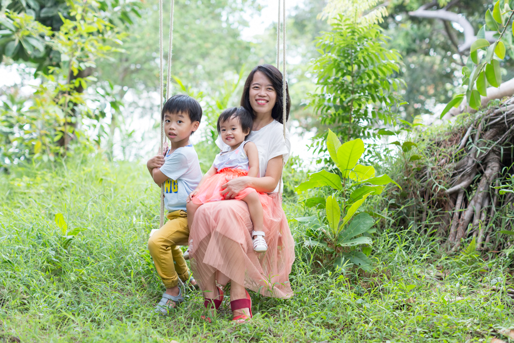 best family photography experience focusing on authentic and connective photographs playful family photoshoot on a swing at east coast park