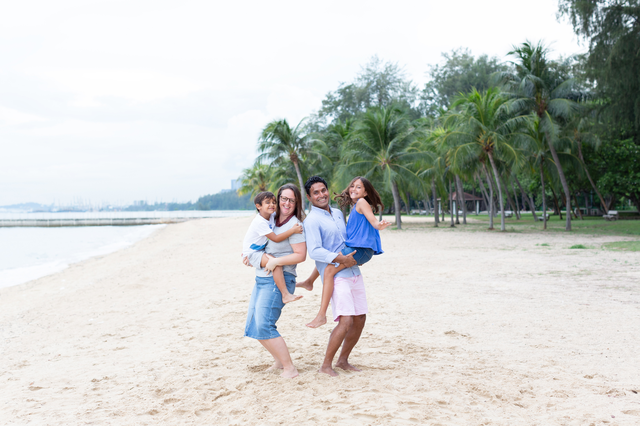 playful family photo session east coast beach family photography singapore gorgeous sunset singapore