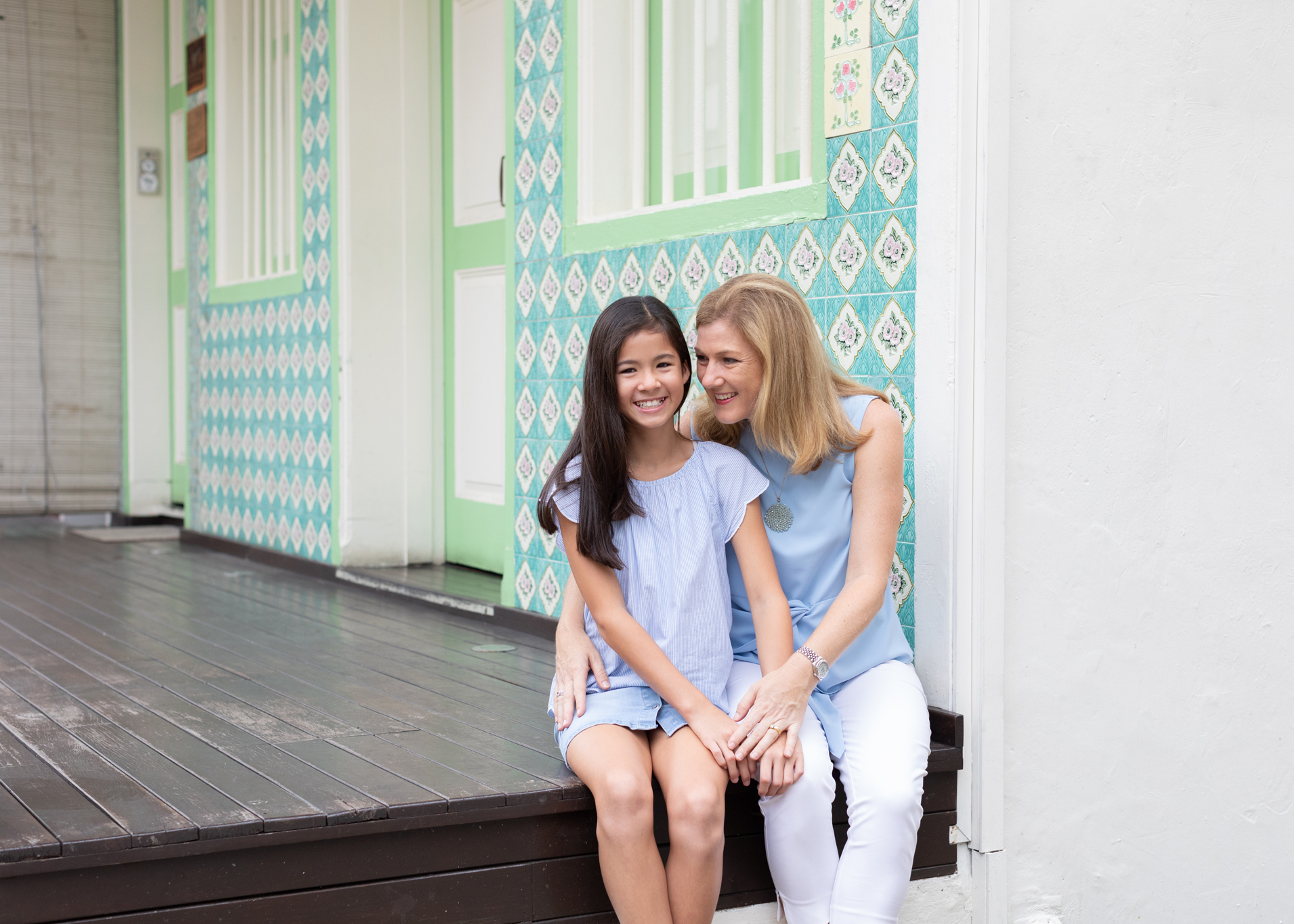 family photoshoot in urban setting mother and daughter laughing