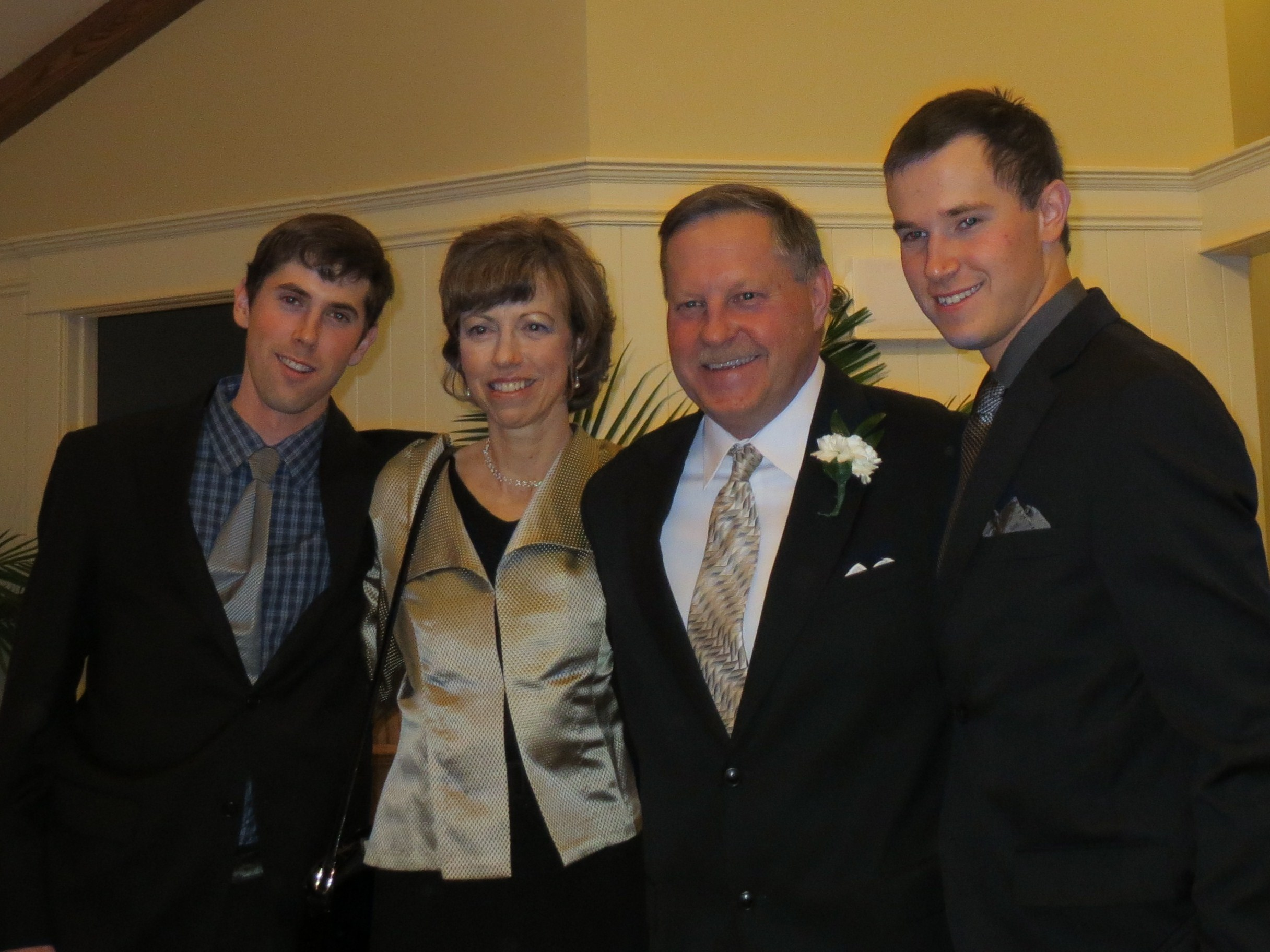 Jim and Monica recommit their wedding vows - with sons Jamie (L) Graham (R)