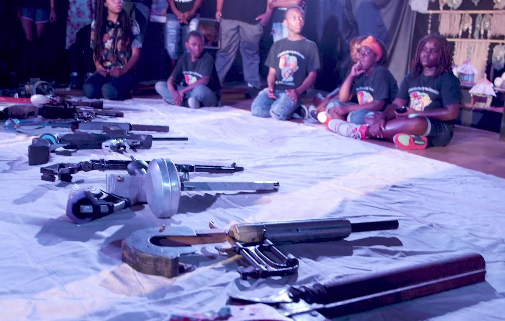 gun show guns on sheet with kids.jpg