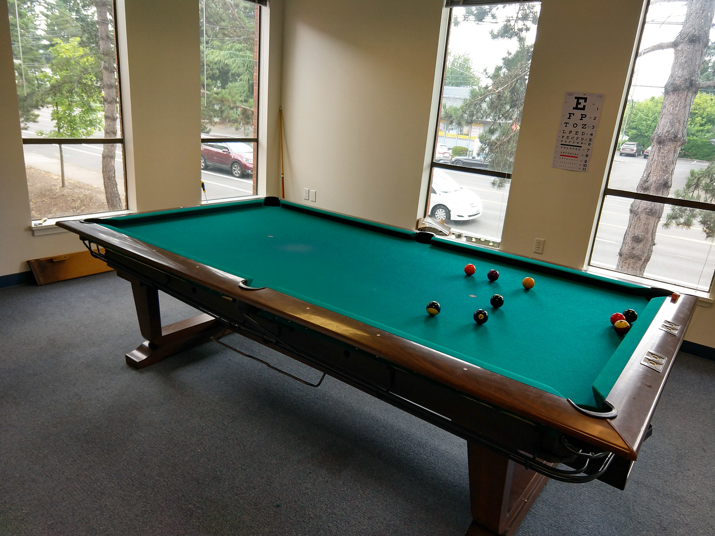 Not quite put back together all the way, but our new pool table at the Shelter