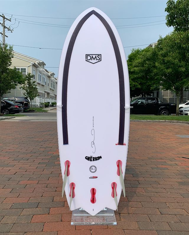 """5'0"""" x 20 1/4"""" x 2 3/8"""" 27.6L Gherkin by @dmshapes X @surftechusa Speed of a Simmons, then equal parts fish and performance groveler. This thing is an absolute small wave destroyer. I've been running to with @fcs_surf Split Keels and they feel soo perfect. I've been playing with this one mostly off camera, including a fantastic day of clean rights in New Jersey, but I've included a little #kookselfie clip from a tiny day at home. If you haven't seen one of these yet, that's because they were super hard to come by previously outside of Australia. They're now filtering into shops in the US and you can check them out online at @surftechusa and @dmshapes 💪🏼 This one is shown off in my crystal clear Wraith rack from @ghost.racks 👻 #dmshapes #surftechusa #surfboard #injectiontech #ronsquiver"""