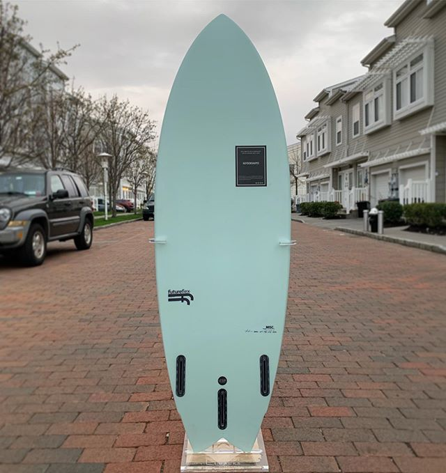 """5'5"""" x 19 5/8"""" x 2 7/16"""" 28.53L Misc. by @haydenshapes in @futureflex construction with a beautiful Menthol tint. I've played with this one in everything from ankle high to shoulder high waves and it's such a versatile all-arounder. Love this thing! 🖤 Slide thru for a #kookselfie and shots of the magic fin setup I settled on for this one thanks to @surf_n_show 's in depth review - @akila_aipa twins with a Rasta trailer, both from @futuresfins I dressed her in a tailpad from @octopusisreal and gave her that perfect bead with @ratcheesegourmetsurf wax. She's shown off here in my crystal clear Wraith rack from @ghost.racks 👻 #haydenshapes #futureflex #resinart #resintint #surfboard #kookselfie #belowaveragejoe #ronsquiver"""
