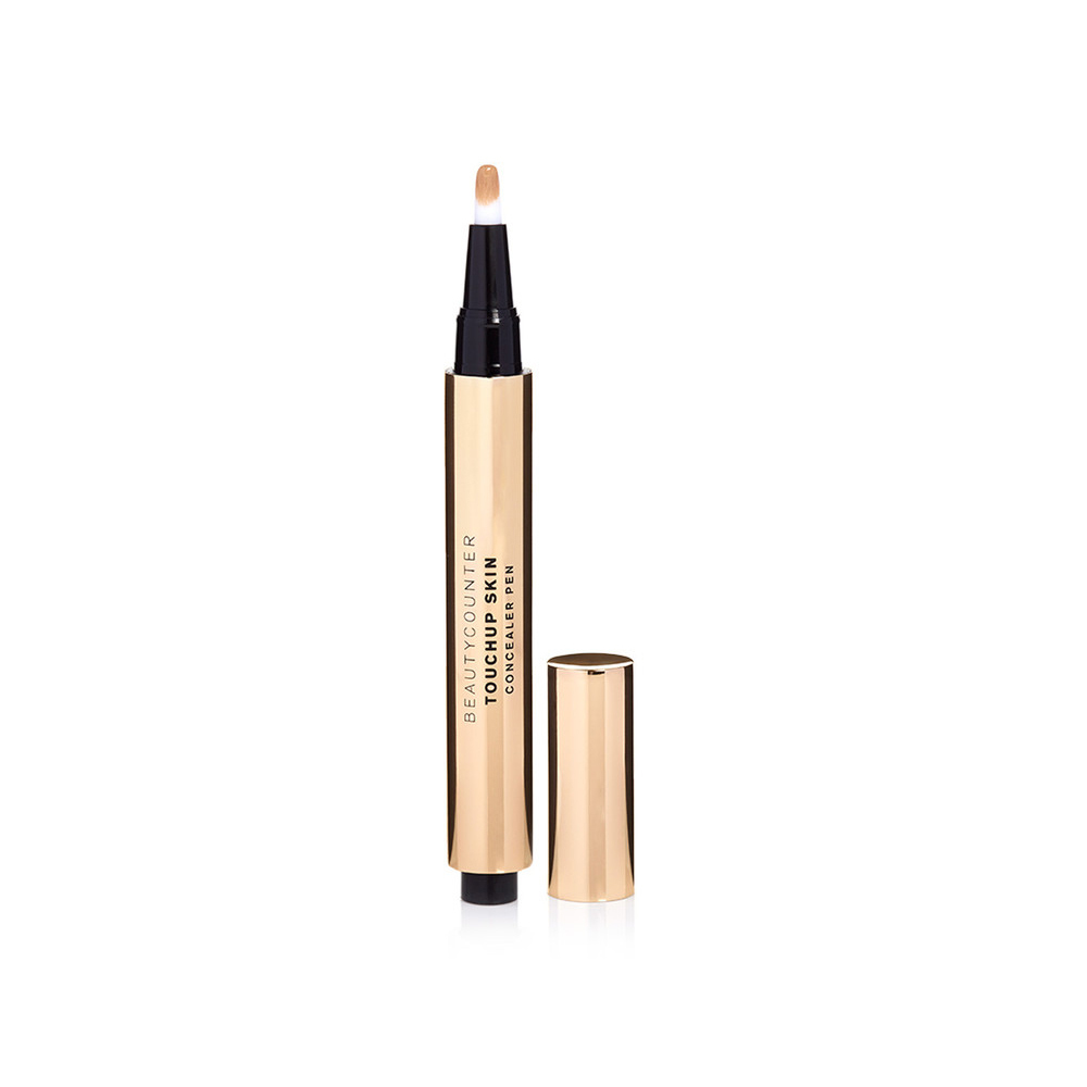 TOUCHUP SKIN CONCEALER PEN  This super-clean, non-toxic, creamy, clickable concealer pen works as well for under-eye circles as it does for blemishes. The shades blend beautifully with practically every skin tone, and the formula miraculously erases flaws yet leaves an gorgeously natural finish.