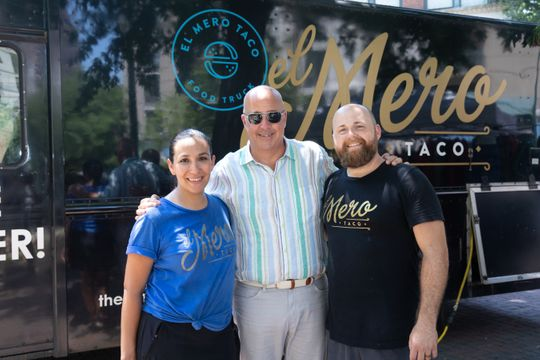 """Clarissa and Jacob Dries with Andrew Zimmern while filming """"The Big Food Truck Tip"""" in 2018"""
