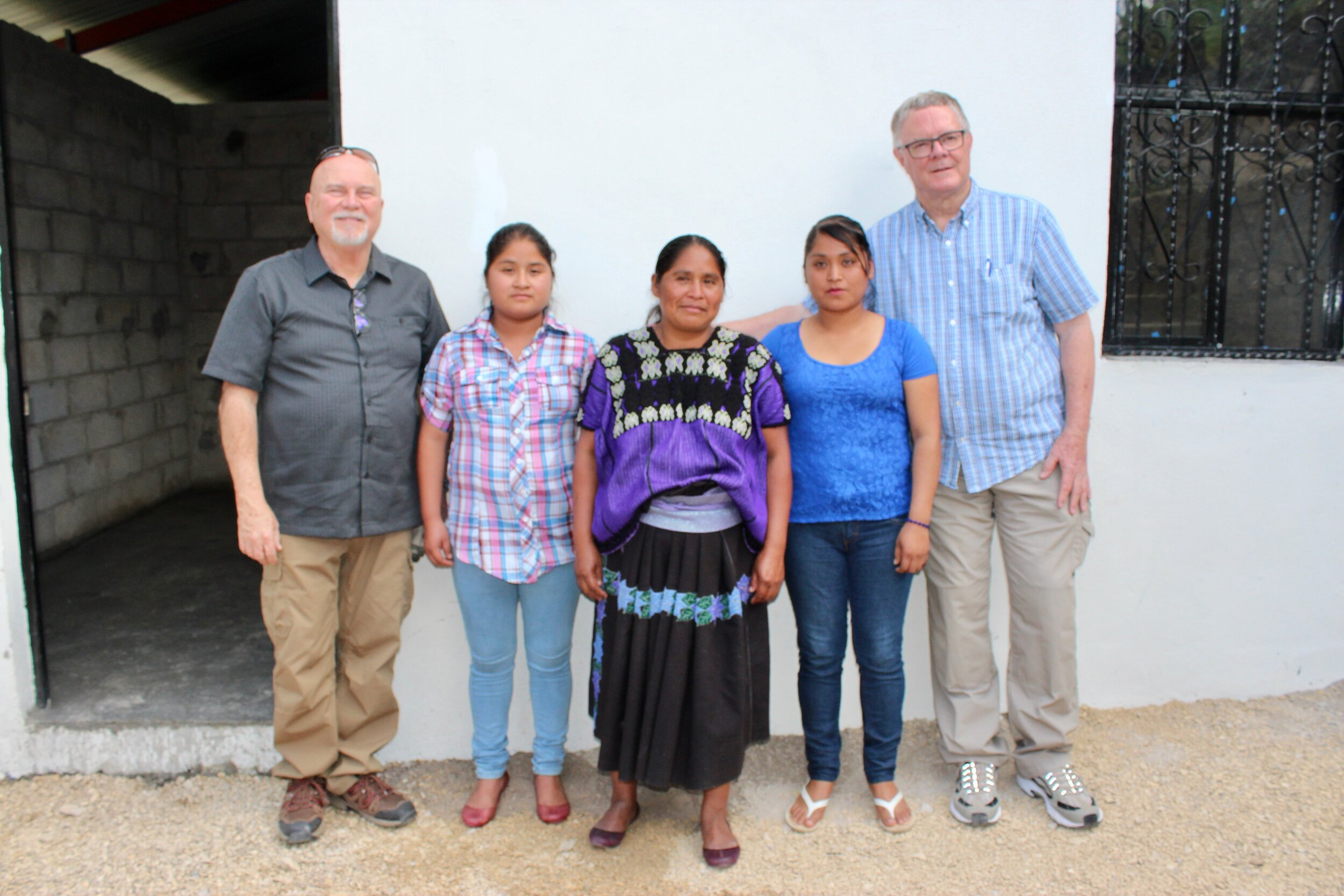 - Marcela López Velasco and her daughters along with Pastor Dino of Lafayette Vineyard and Al Brown of TX.
