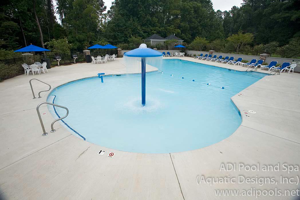 5-community-pool-with-large-sunshelf.jpg