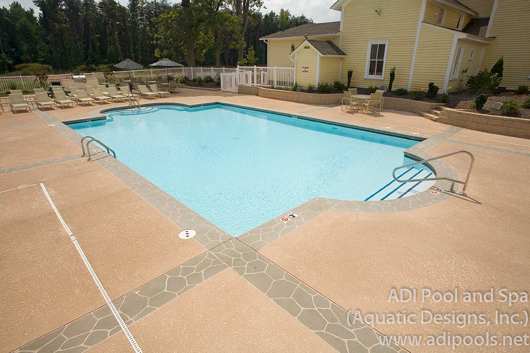 1-commercial-swimming-pool-with-stamped-concrete-border-and-knockdown-deck-topping.jpg