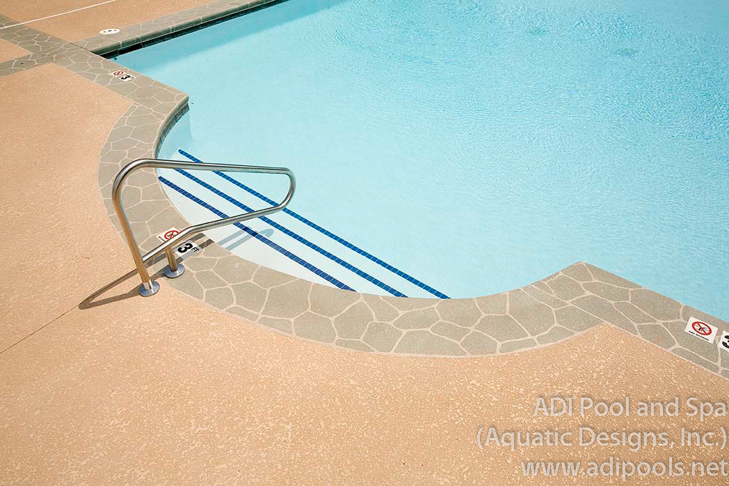 6-community-pool-with-stamped-concrete-border.jpg