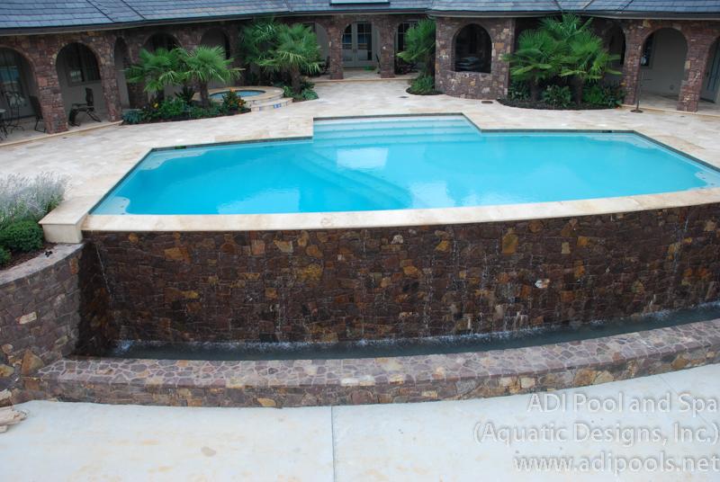 4-infinity-edge-pool-with-stone-cap.jpg