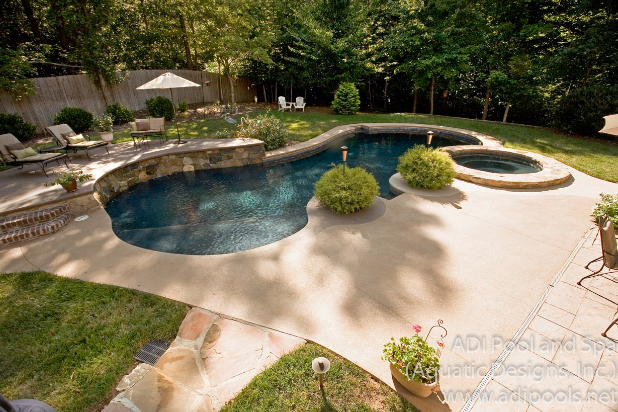 9-pool-and-spa-combination-with-raised-rock-waterwall.jpg