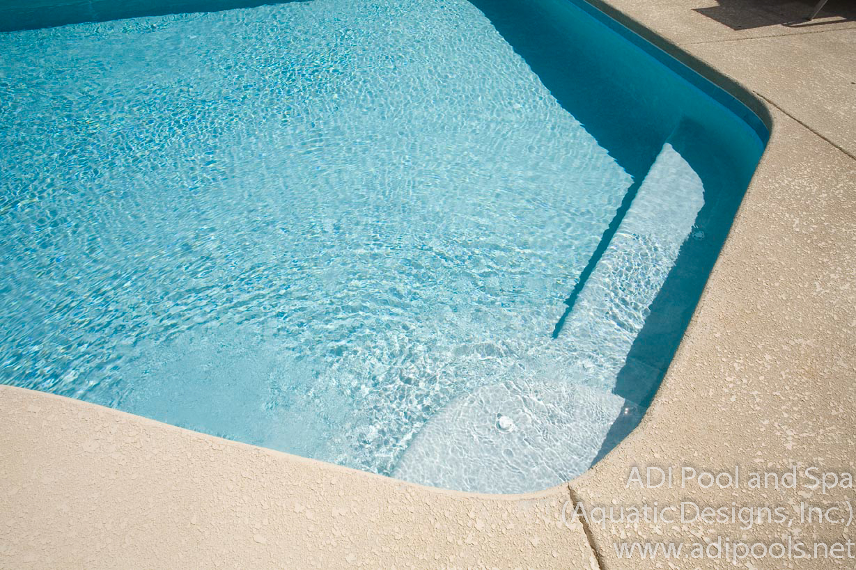 6-swimming-pool-with-custom-underwater-steps-and-bench.jpg