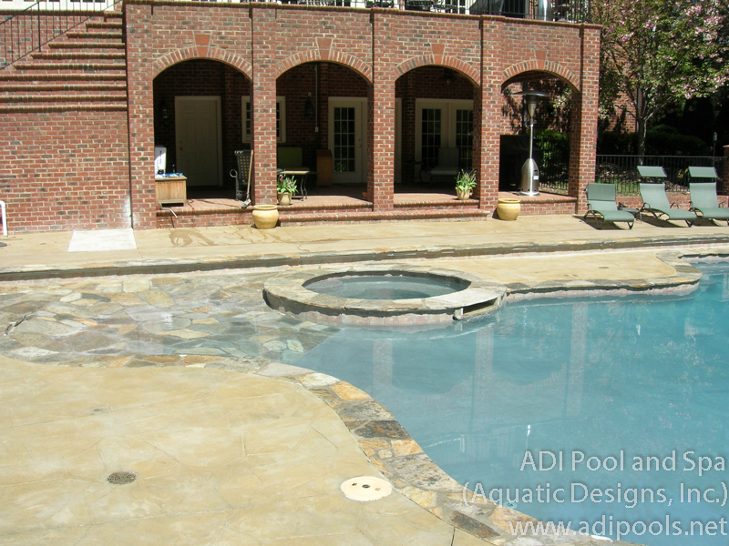 6-pool-with-beach-entry-and-spa.jpg