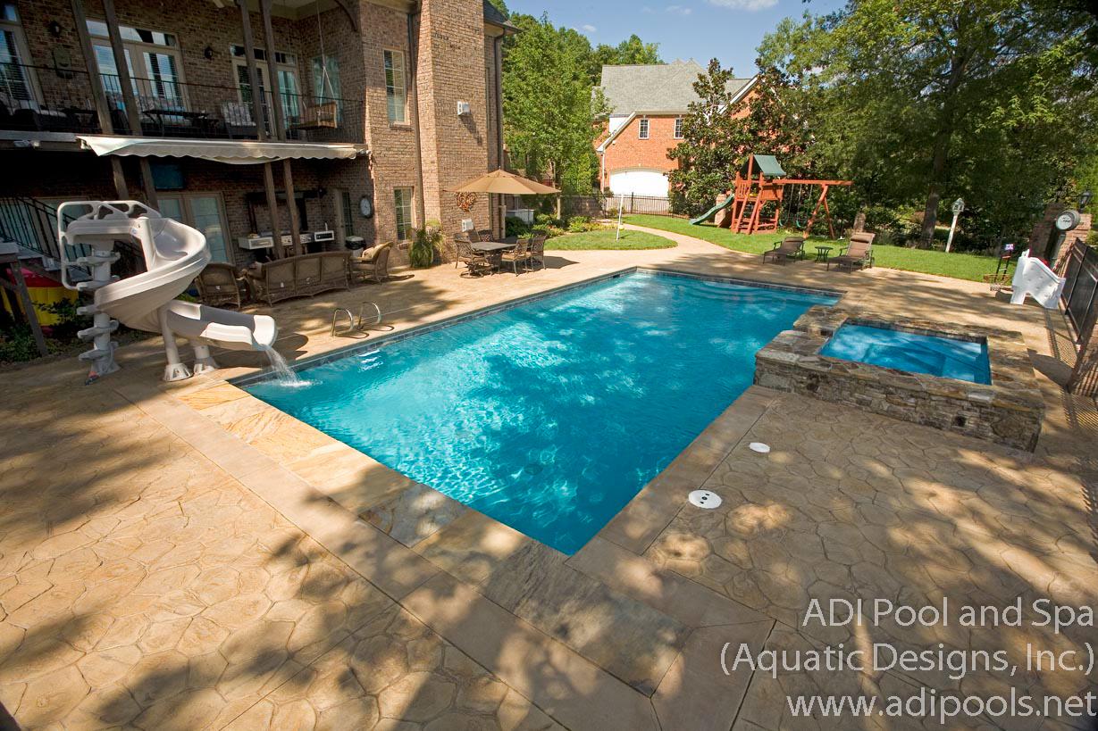 8-stamped-concrete-pool-deck-at-pool-and-spa.jpg