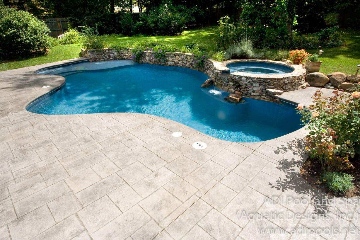 8-residential-swimming-pool-with-stamped-concrete-deck.jpg