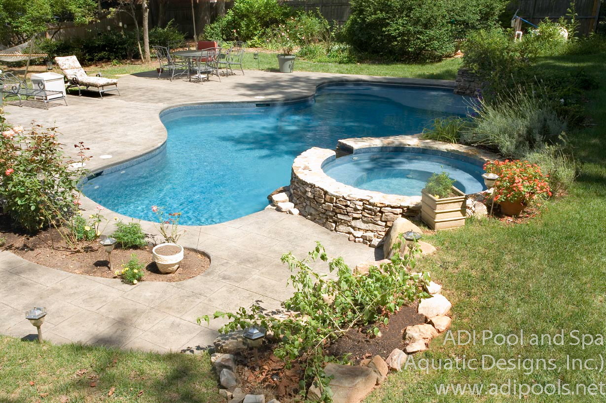9-shotcrete-pool-with-spa-and-sunshelf.jpg