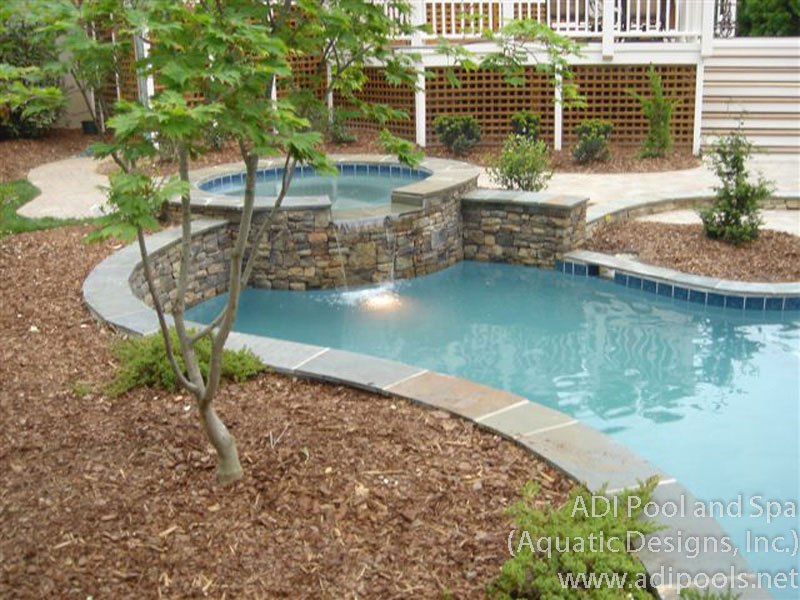 pool-spa-combination-with-stone-retaining-wall.jpg