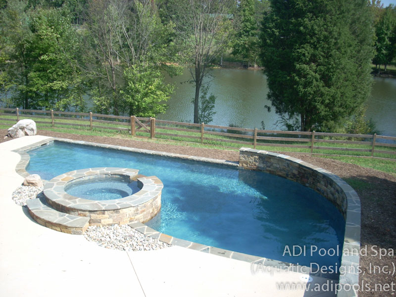 swimming-pool-with-spa-and-raised-wall.jpg