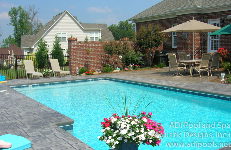 swimming-pool-with-stamped-concrete-deck.jpg