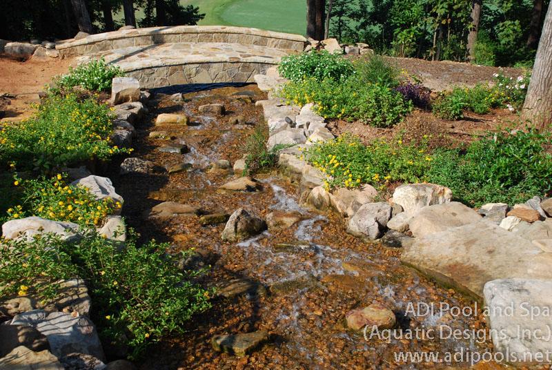 natural-rock-waterfall-with-bridge.jpg