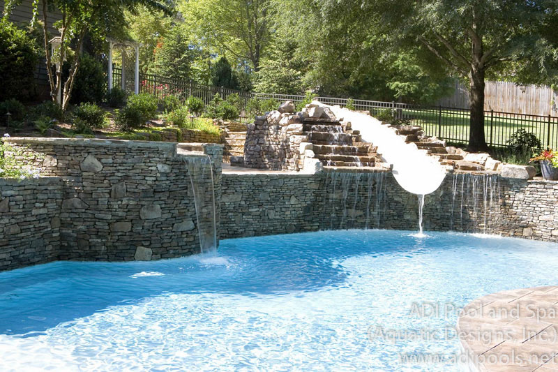 pool-with-natural-rock-waterfall-and-waterslide.jpg