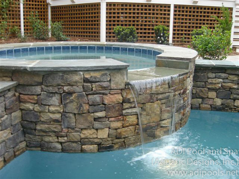 stone-spa-with-spillover-in-raised-wall.jpg