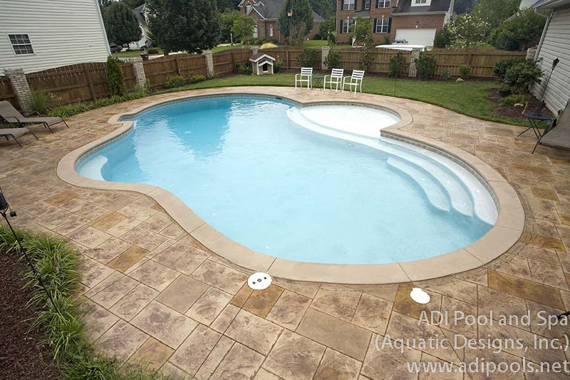 pool-with-sunshelf-and-custom-underwater-steps.jpg