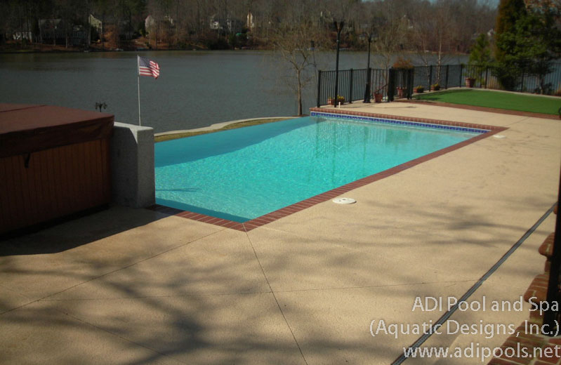 infinity-edge-pool-with-stamped-concrete-border.jpg