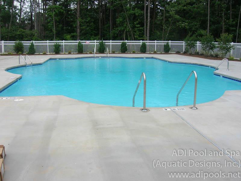 community-pool-with-broom-finish-concrete-pool-deck.jpg