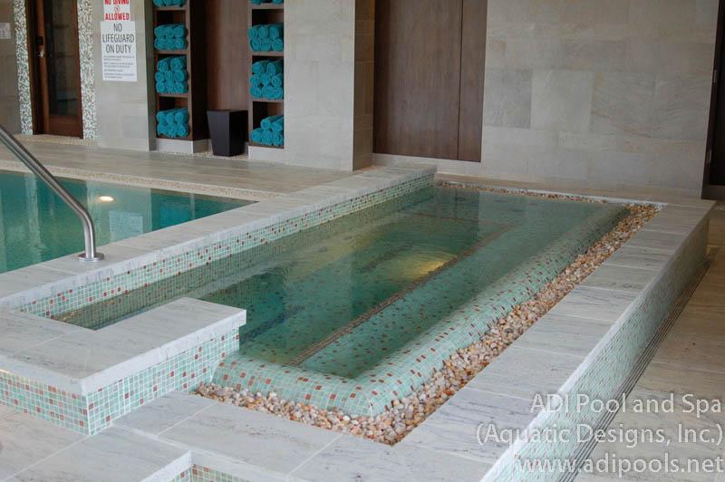 indoor-commercial-spa-with-rock-overflow.jpg