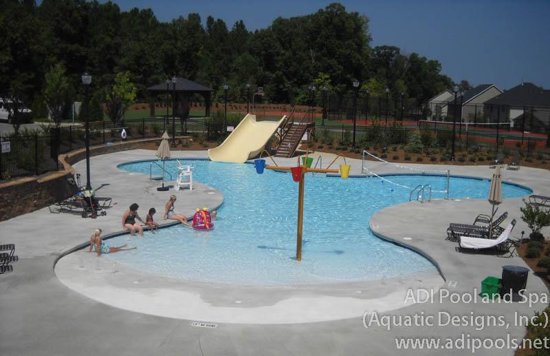 beach-entry-community-pool-with-water-slide.jpg