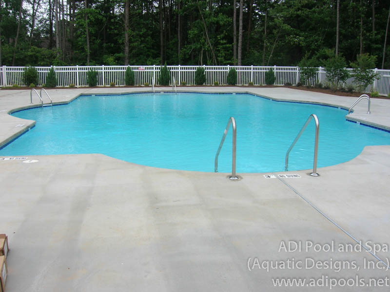 community-pool-with-broom-finish-concrete-pool-deck.jpg