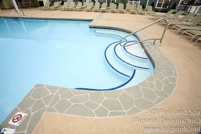 community-pool-with-custom-underwater-benches.jpg