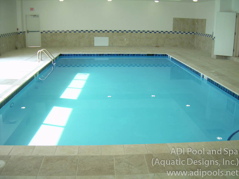 indoor-swimming-pool-with-travertine-deck-and-coping.jpg