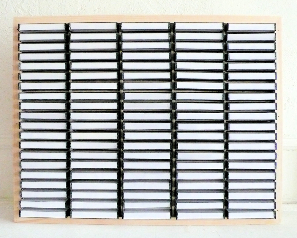 Top 100 jazz Lp's 1969-79 (album list presented as title card) . Paper, cassettecases, plywood. 18 x 24 x 3 in. 2010.