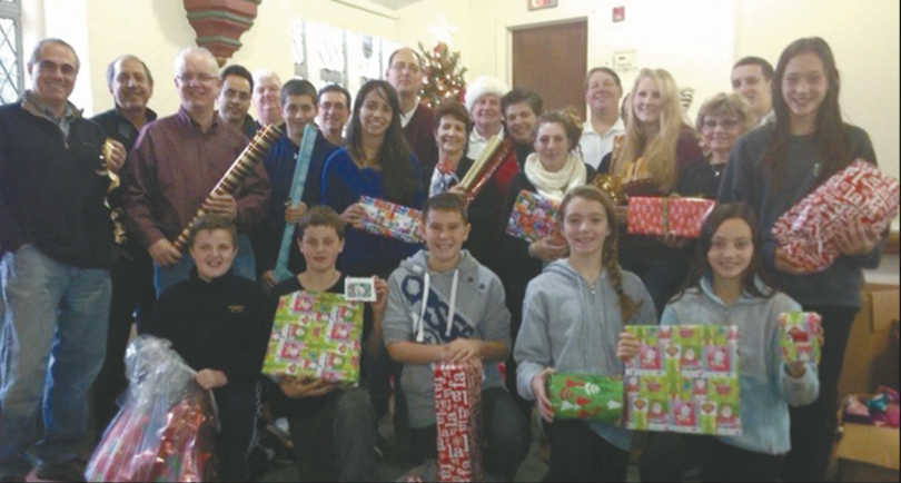 Pelham Civics volunteers, members, families, and friends, wrapped and then delivered gifts for children in the community