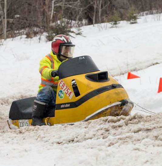 Gord at a snowmobile race, taking names against the young guys with his sweet Ski-doo