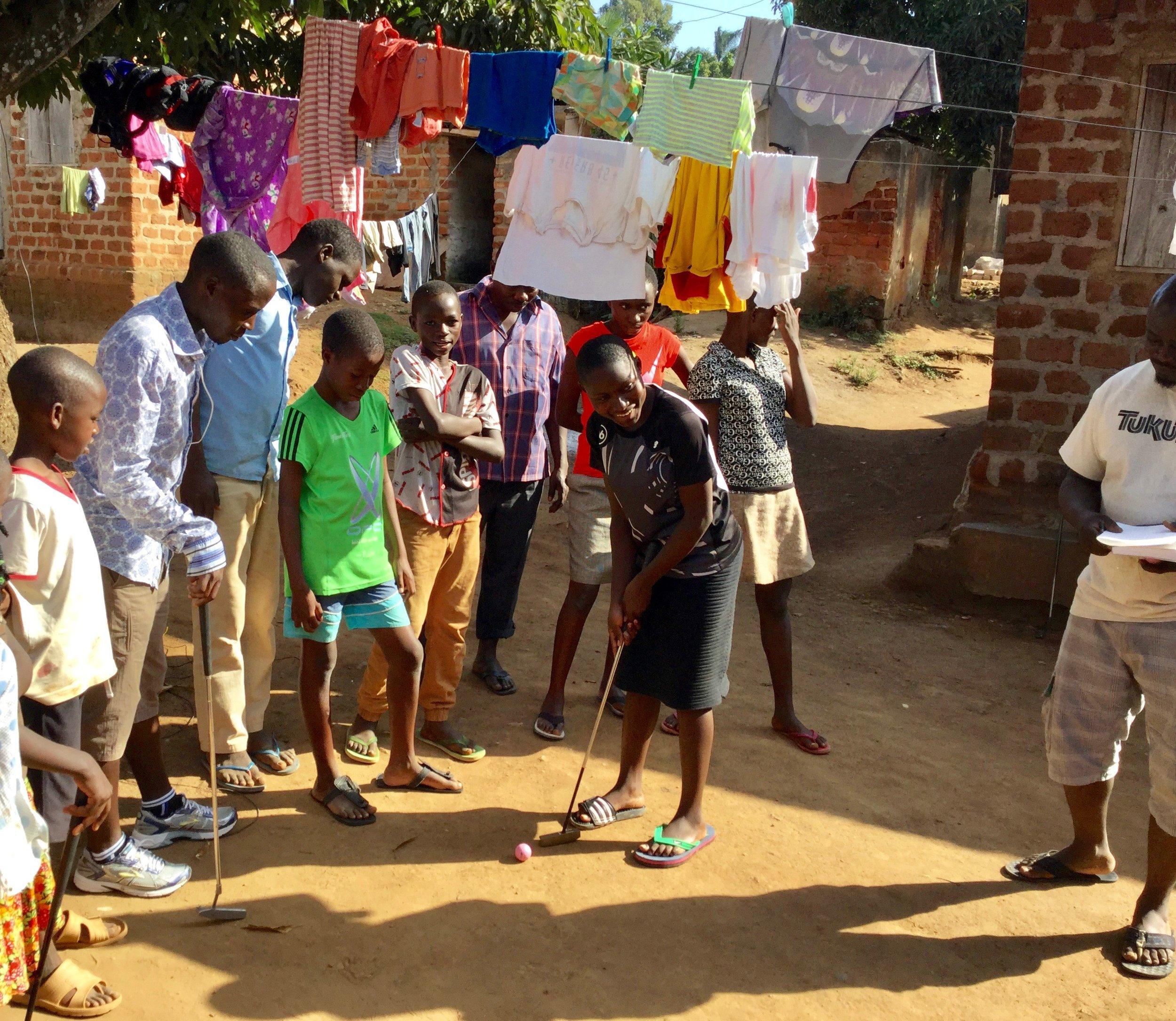 Putting practice at the Tukutana Community Center in Munyonyo, Uganda.