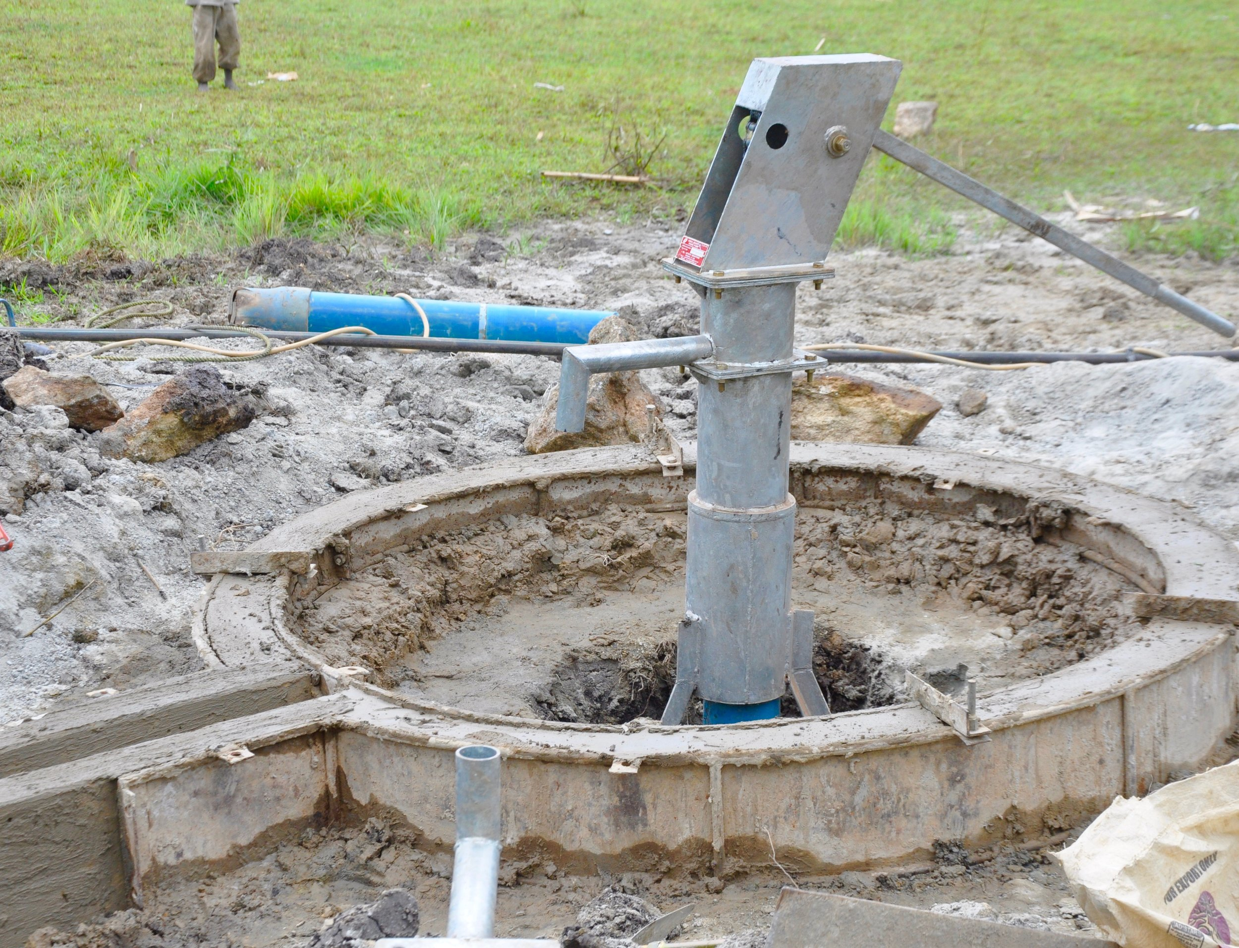 Step 6: Cast   After reaching the desired water table, the borehole and pipes are flushed until the local water inspector gives a report indicating the water is pure and safe to drink. At that point a hand pump and cement drainage tunnel are cast. Following a ceremony to thank God for the provision of water, the well begins serving the church and community.