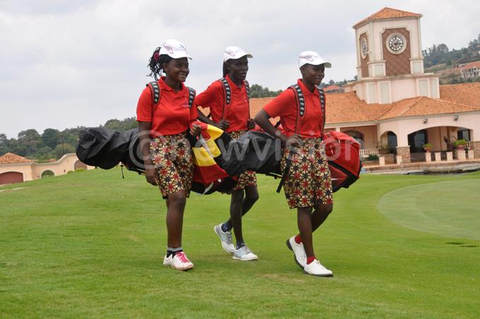 Uganda's girls' team at the Lake Victoria Serena Golf Resort course. L-R: Joan Nampewo, Loyce Bako and Milly Nambooze. PHOTO: Michael Nsubuga
