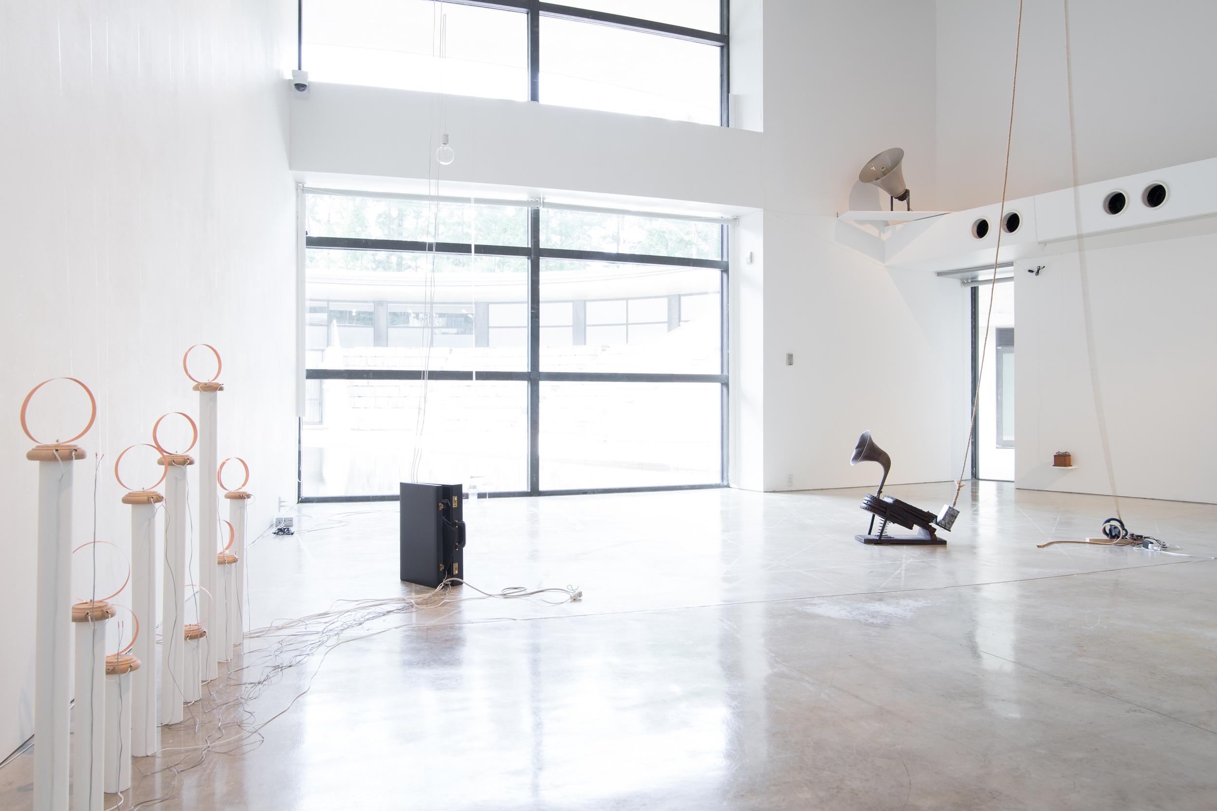 Yuko Mohri   Calls,  2013-14 Installation View at Aomori Contemporary Art Center (ACAC), Aomori, Japan,2014 Photo Credit: Kuniya Oyamada bells, fork, glass, horn, electric magnet, ribbon, cloth, coil, suitcase, etc. dimensions variable