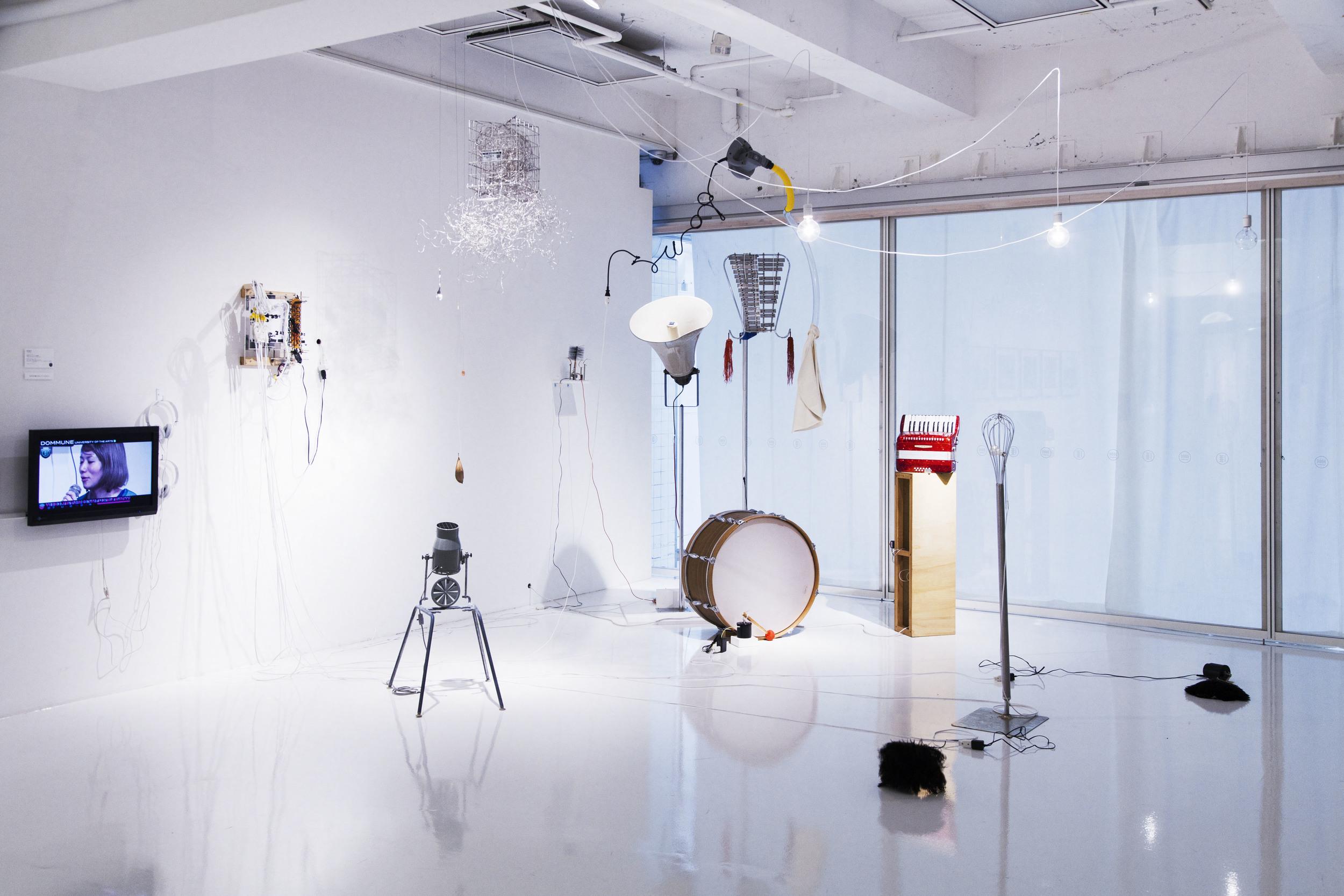 Yuko Mohri   Ofuna Flower Center,  2011-15 Installation View at 3331 Arts Chiyoda, Tokyo, Japan, 2014 Photo Credit: Hiroaki Sagara bell-lyras, balloon, blower, bass drum, whisk, Japanese pampas, grass, lamp bulbs, etc. dimensions variable