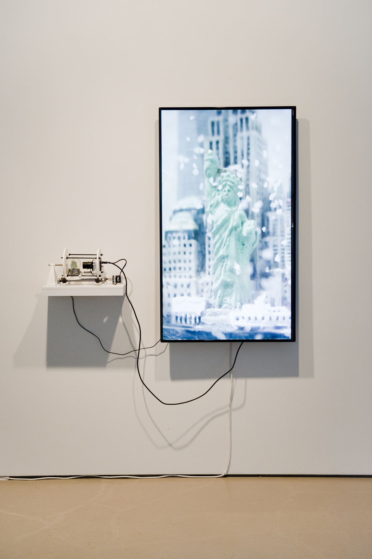 Simulation of a   Simulation (New York),  2015 camera, TV, snowglobe, motor, 3D printed parts, computer 50 x 50 x 9 inches