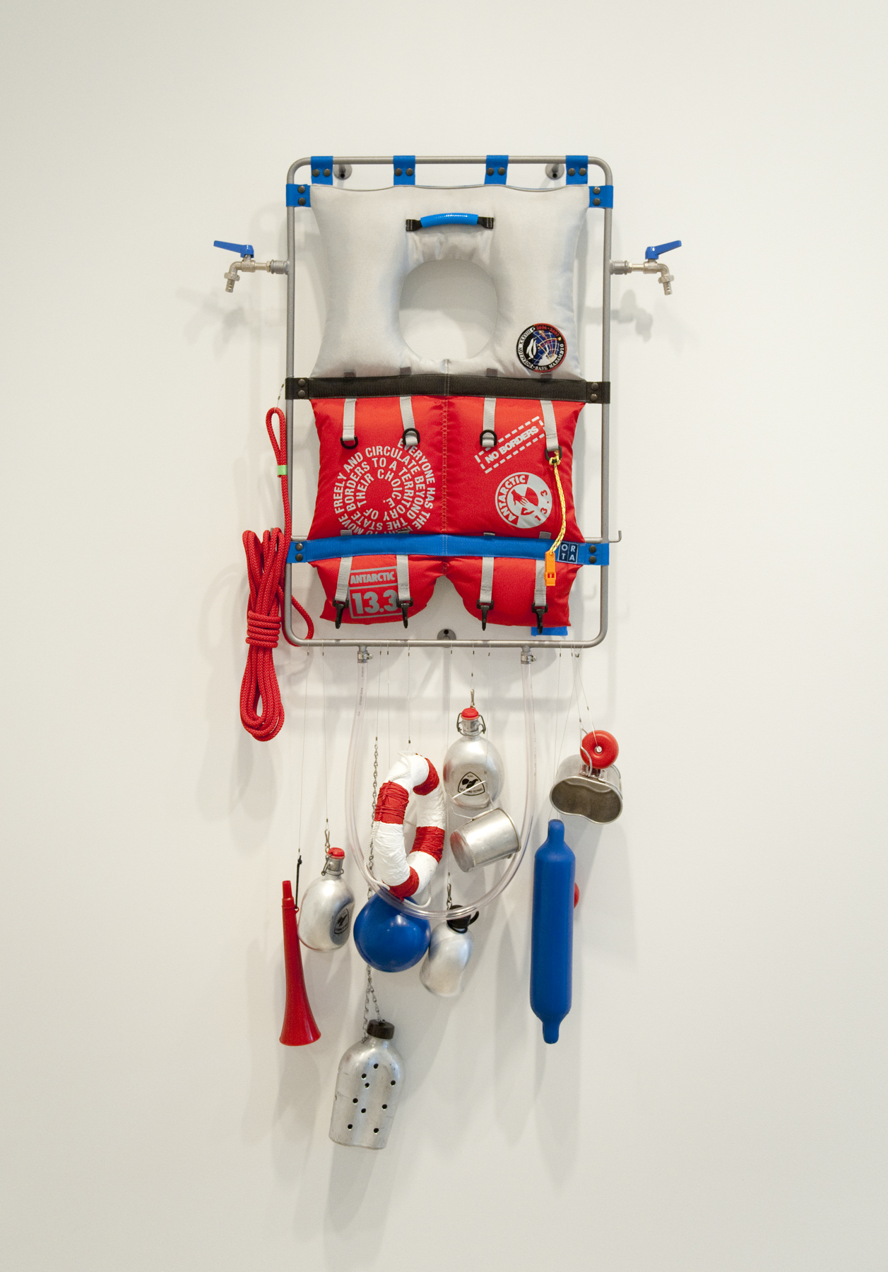 Lucy + Jorge Orta   Life Line - Survival Kit , 2008 steel frame, 2 taps, piping, various textiles, silkscreen print, webbing, rope, 2 floats, ring, horn, various water flasks and containers 59.06 x 31.5 x 5.91 inches 150 x 80 x 15 cm