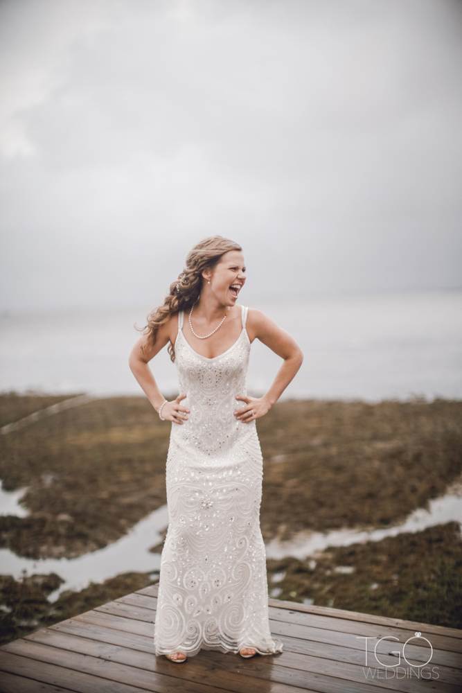 The bride does not let the hurricane get in the way of having a perfect wedding.