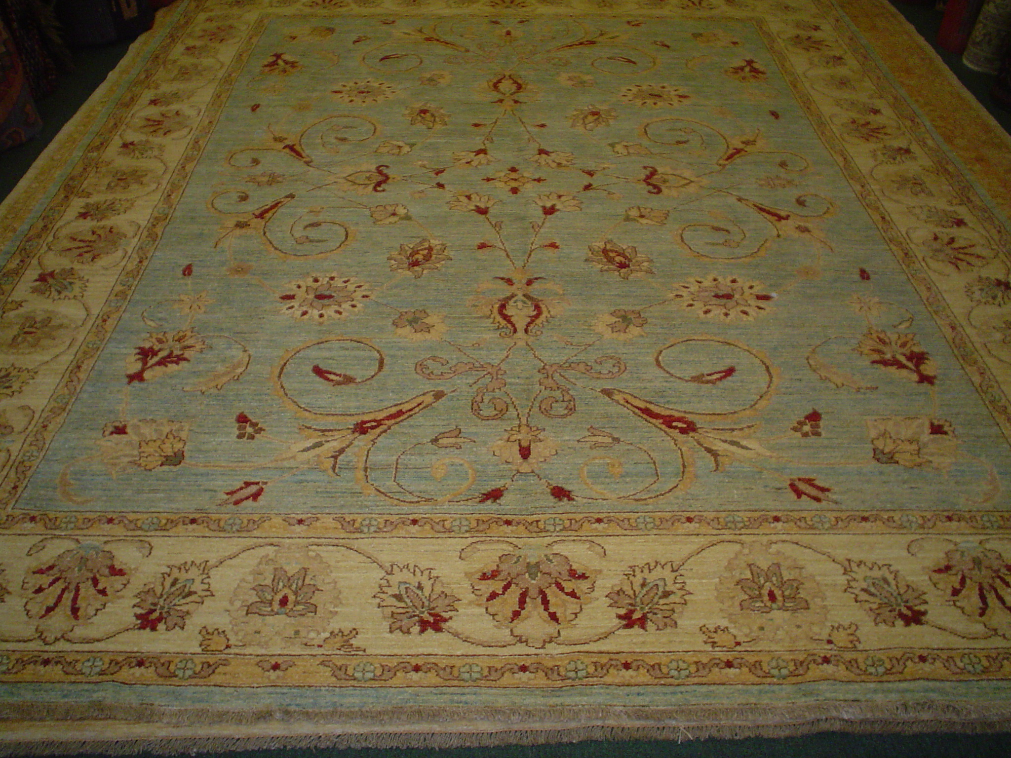 #4) 8 x 10 light blue Afghan rug in an overall Herati design.