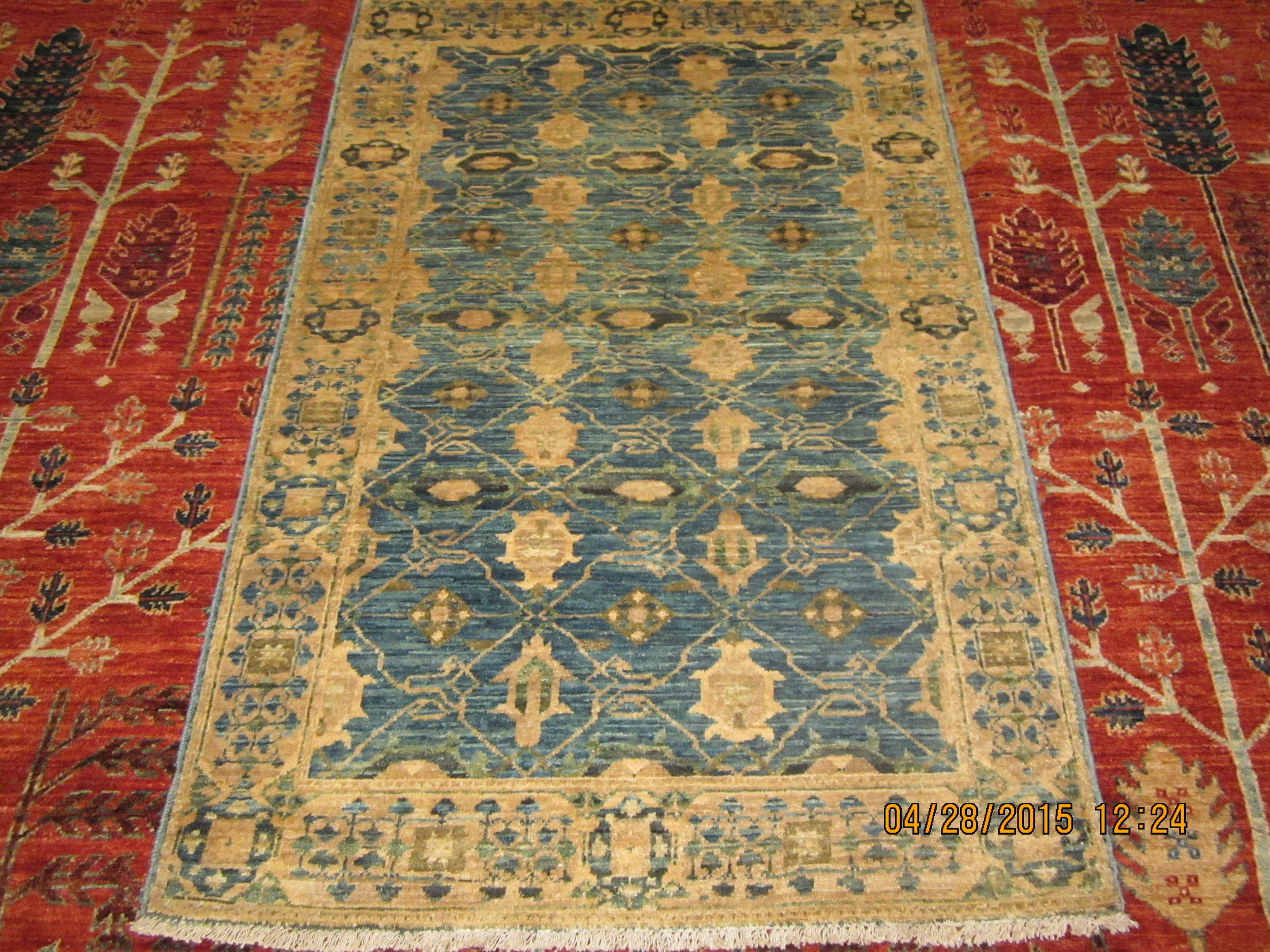 """#6) 2'9"""" x 4'4"""" Antique look, new Afghan rug in light blue."""