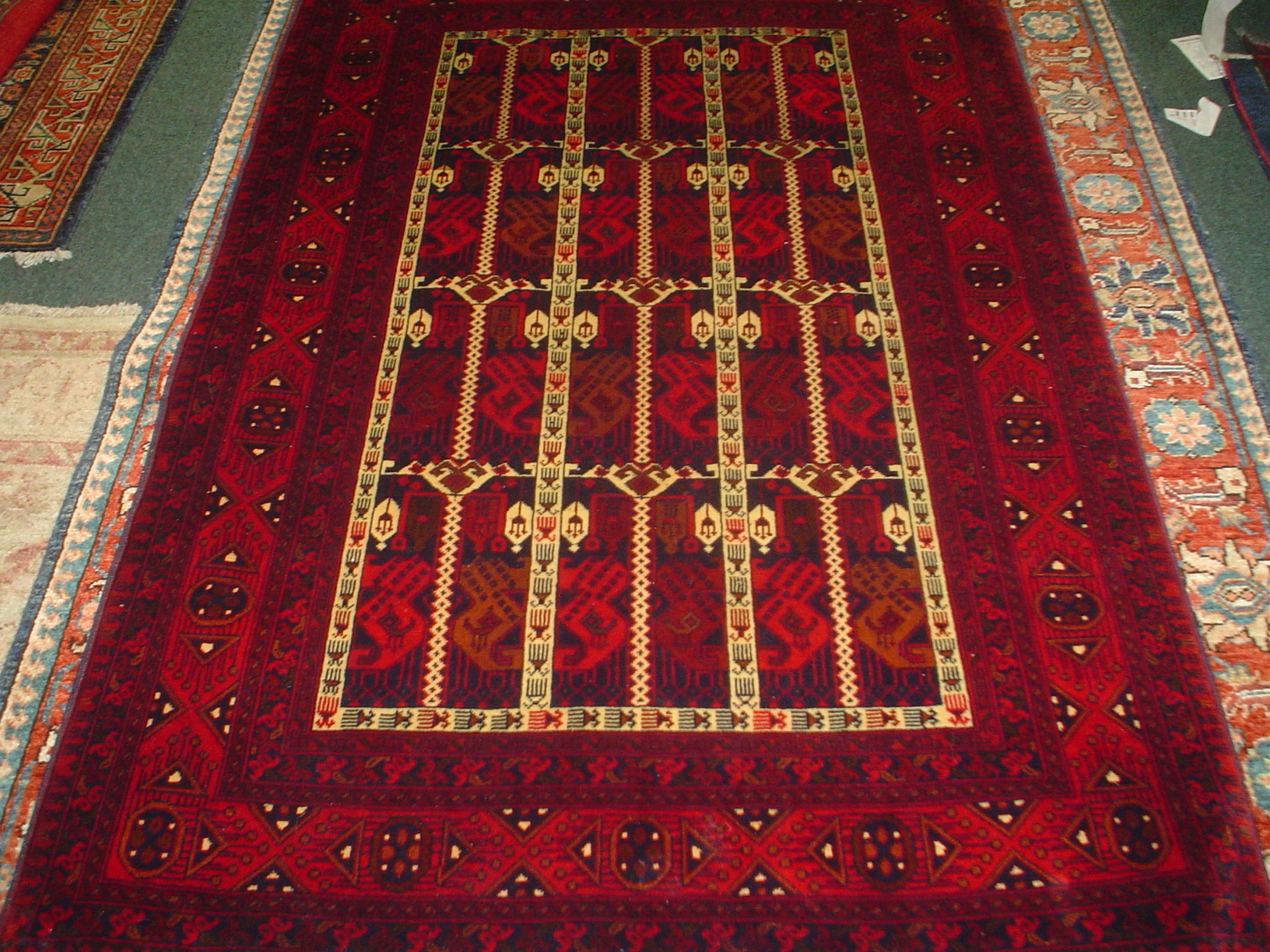 #8) 3.4 x 5 Small Afghan rug. Finely woven in deep red.