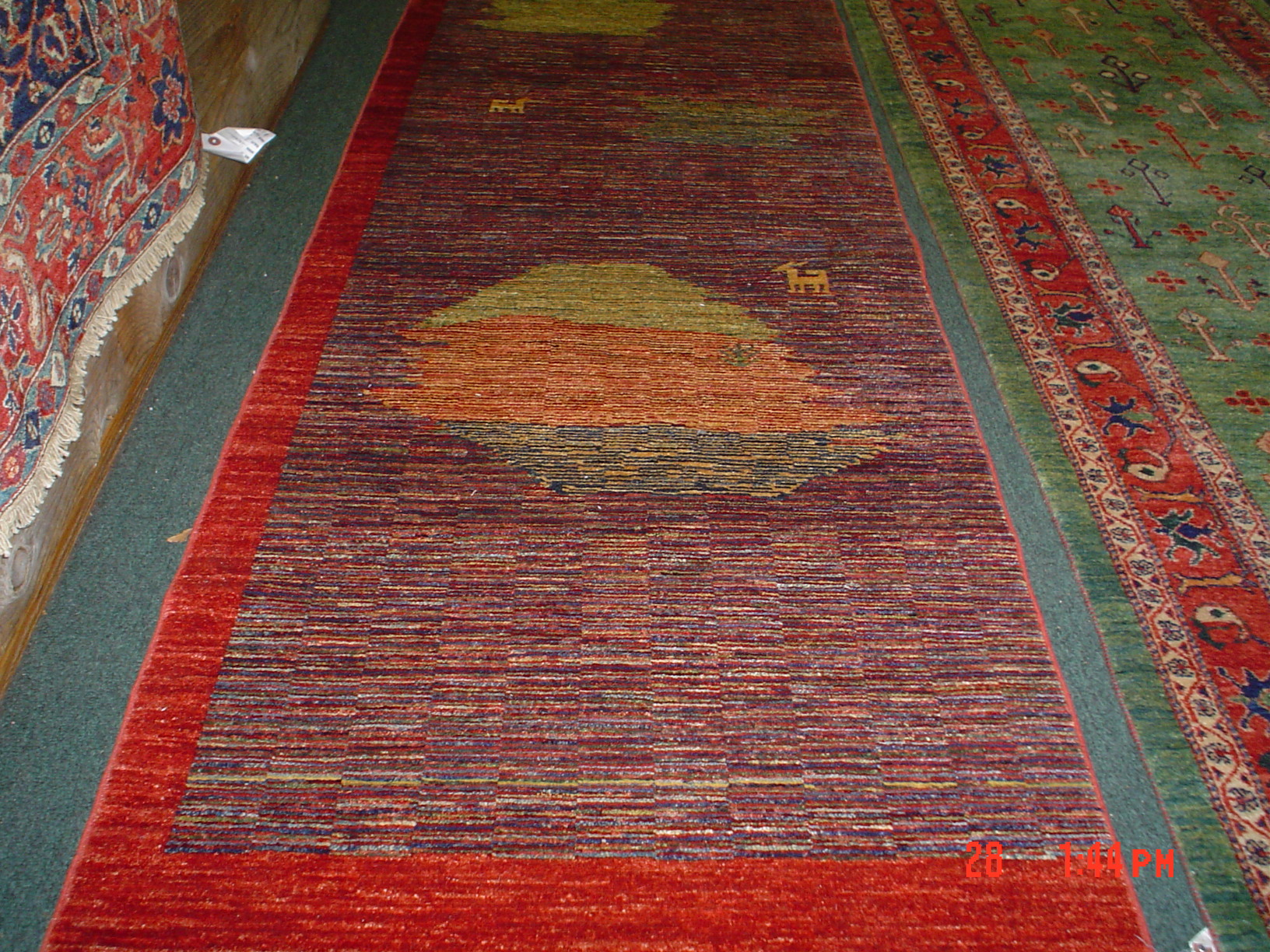 "#14a) Smaller modern Afghan runner. 2'6"" x 8', very finely woven. Multi-colored small runner in a modern design."